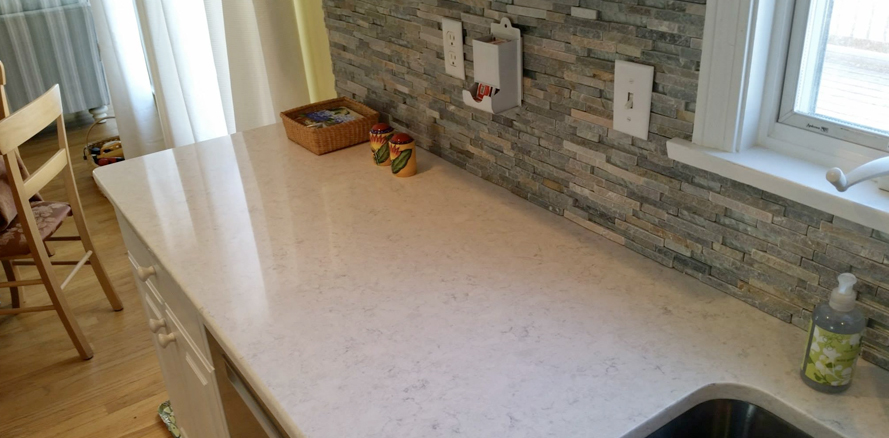 granite countertop & tiled backsplash