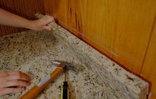 person installing granite countertop