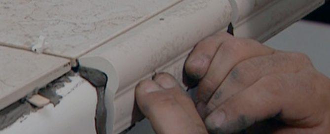 hands placing tile pieces