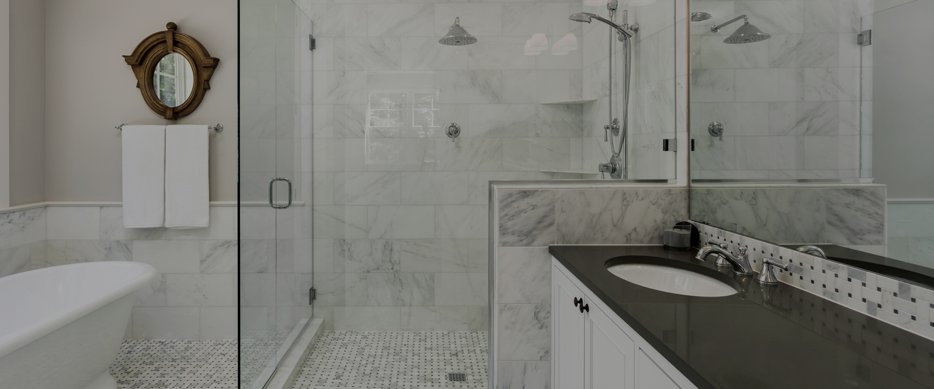 white tiled bathroom shower