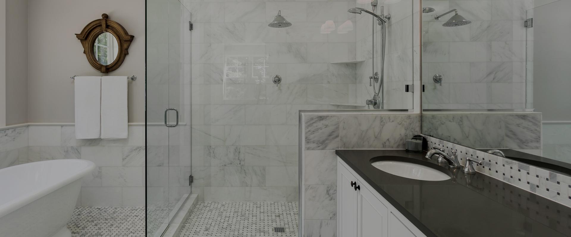 white tiled bathroom shower
